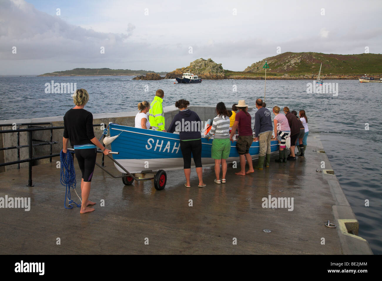 Lauching a boat for gig racing on the Isles of Scilly - Stock Image