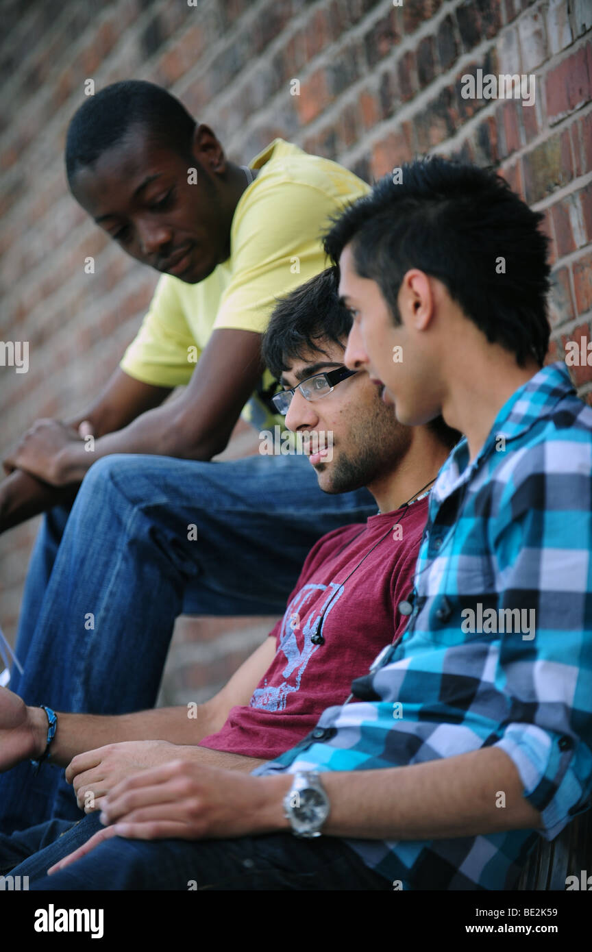 Students take a break between study at a sixth form further education college - Stock Image