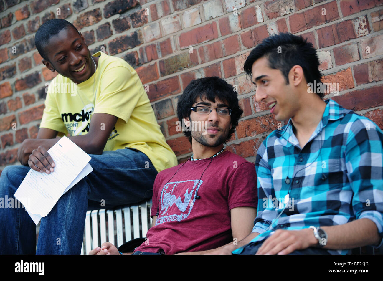 Students relax on break at a sixth form further education college - Stock Image