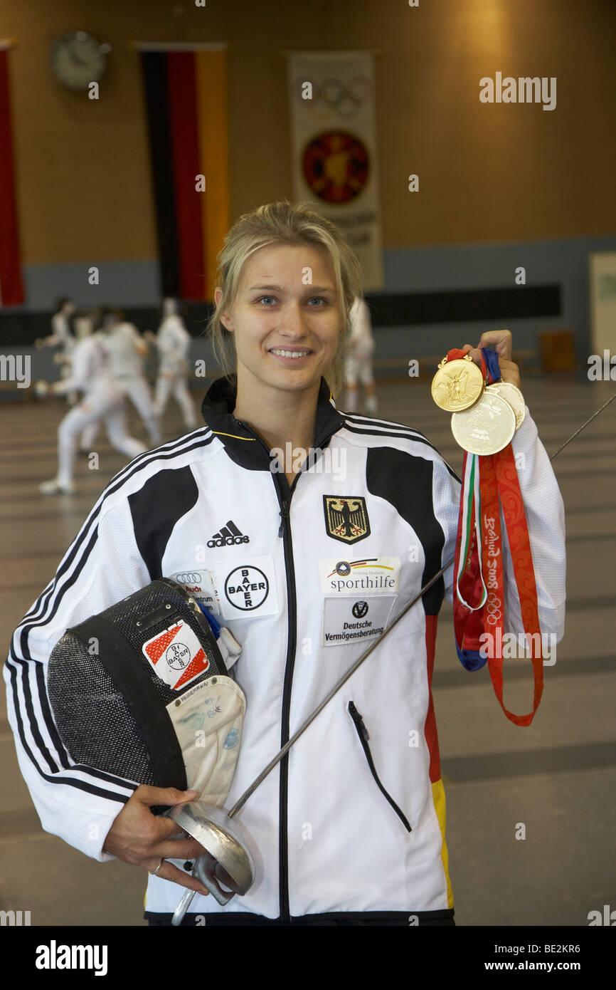 Epee fencer Britta Heidemann, TSV Bayer 04 Leverkusen, showing her gold medals, Bonn, North Rhine-Westphalia, Germany, - Stock Image