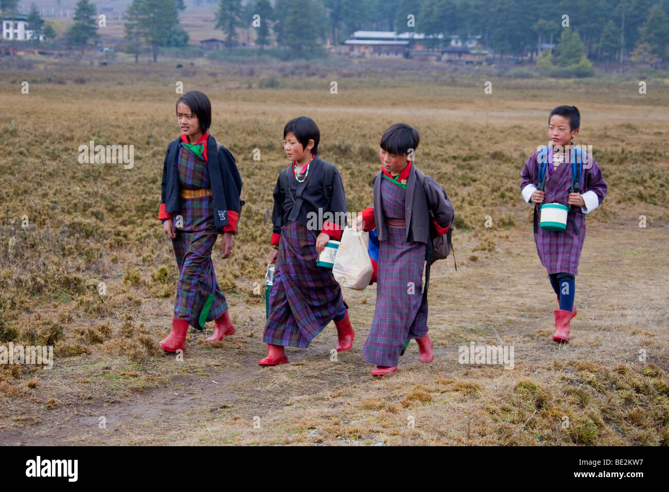 Young school children  wearing traditional dress uniform in school near Gantey Bhutan Asia. 91904_Bhutan-Wangdue - Stock Image