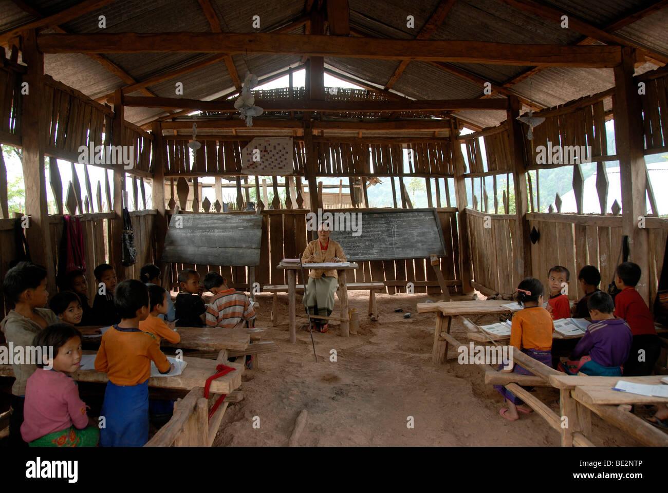 Poverty, education, school, simple village school, pupils of the Akha Pixor ethnic group, teacher, village Ban Moxoxang, Stock Photo