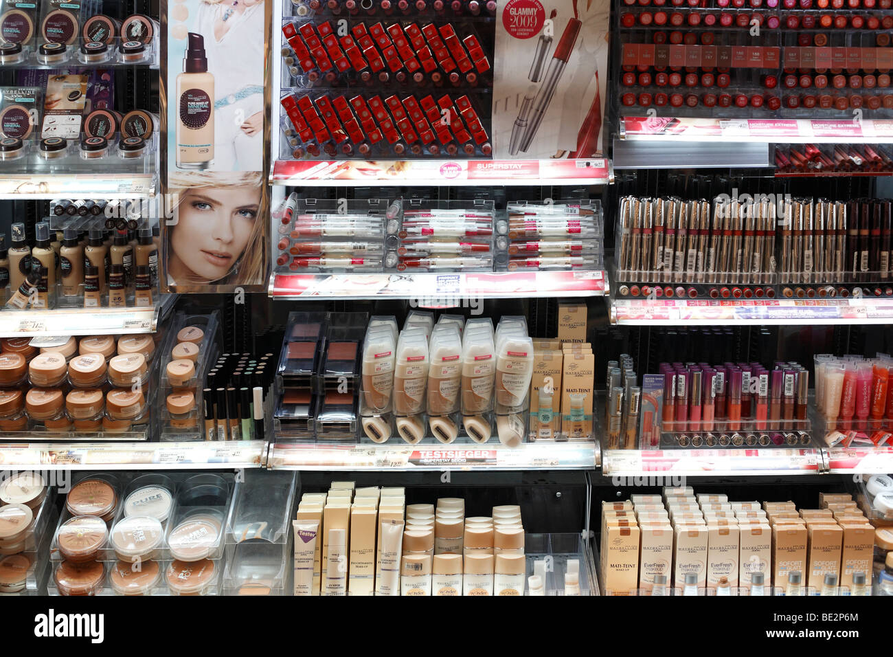 cosmetic shelf in a chemist's shop - Stock Image