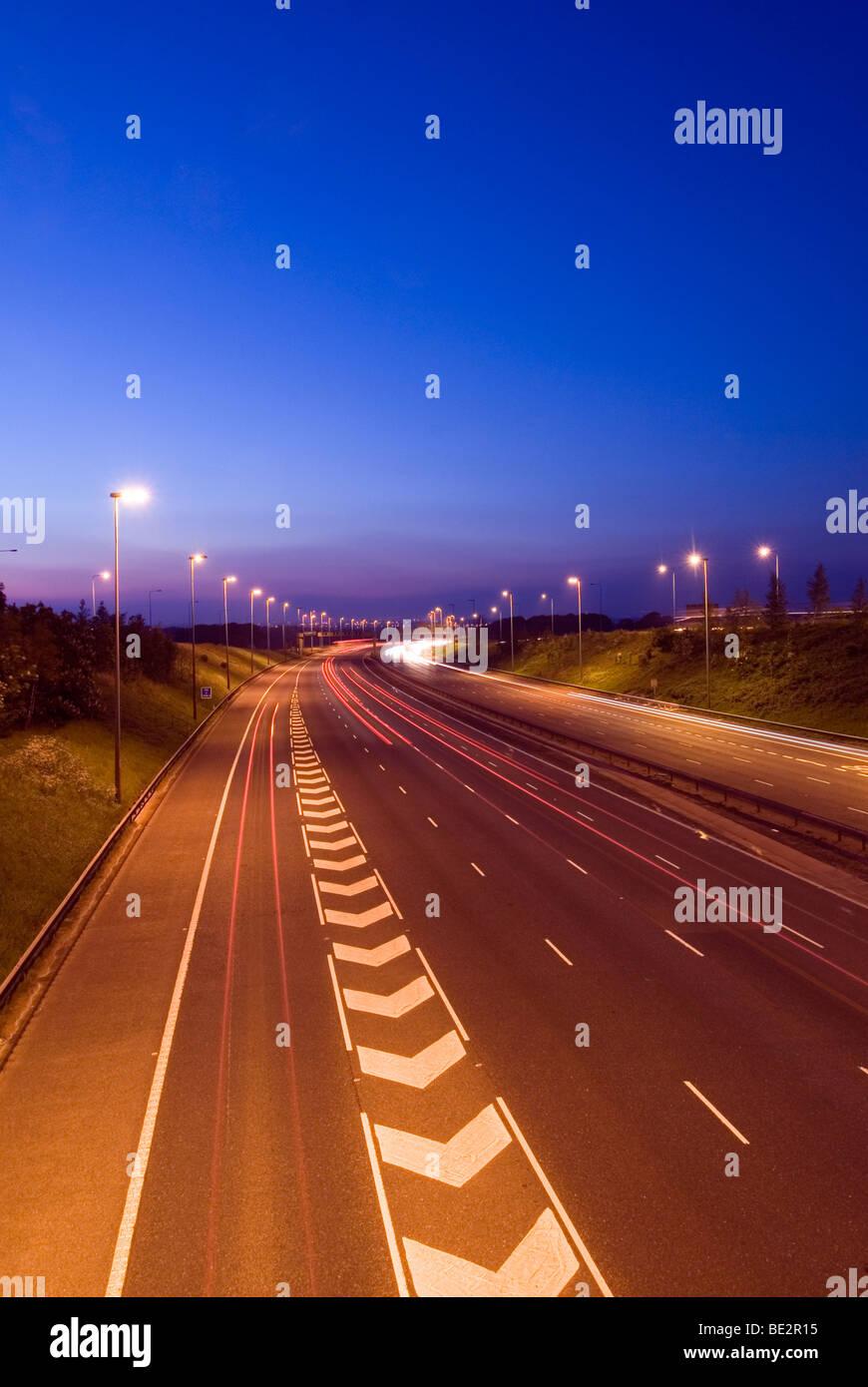 White chevron road markings on M6 motorway north, Thelwall Viaduct, Warrington, Cheshire Stock Photo