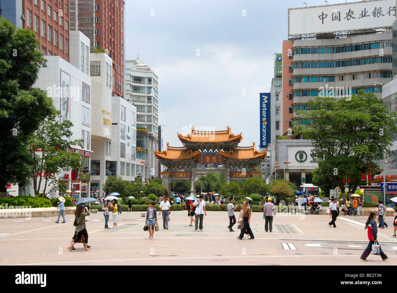 Busy pedestrian zone in the modern city center, Kunming, Yunnan Province, People's Republic of China, Asia - Stock Image