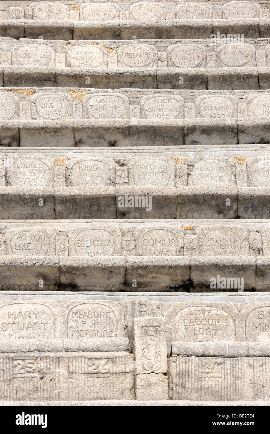 Spectator seats with sculpted backrests in the Minack Theatre, amphitheater at Porthcurno, south coast of Cornwall, - Stock Image