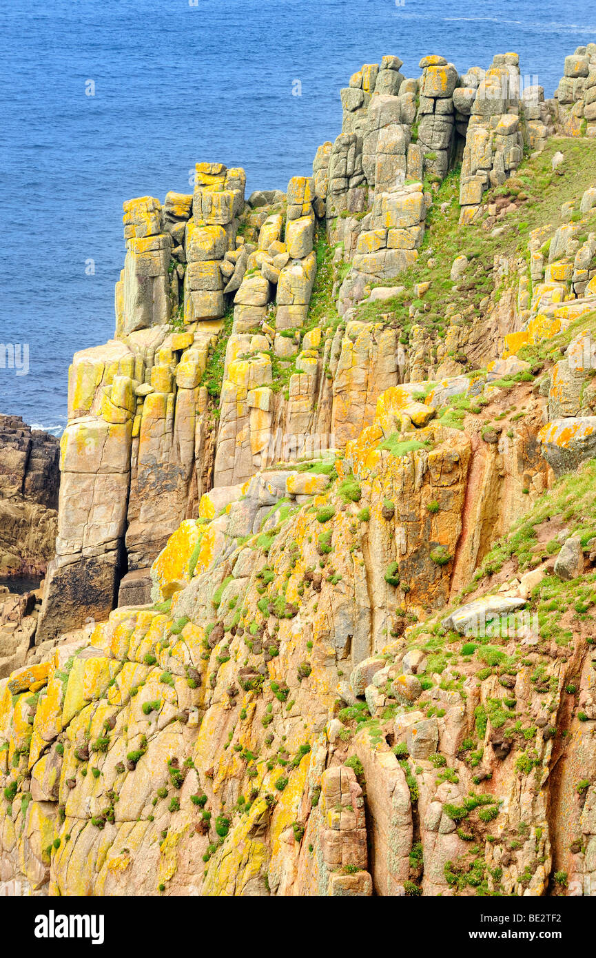 Bizarre cliff formations on the steep coast of Land's End, Cornwall, England, UK, Europe - Stock Image