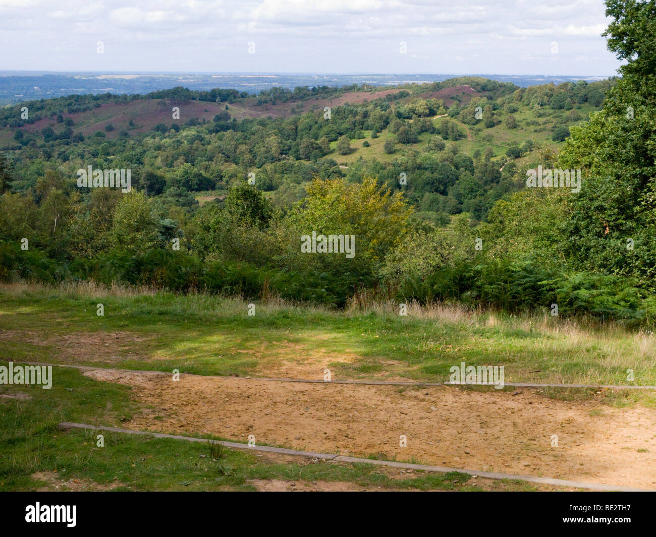 A view over the Devil's Punchbowl with a footpath in the foreground. Hindhead. Surrey. UK. - Stock Image