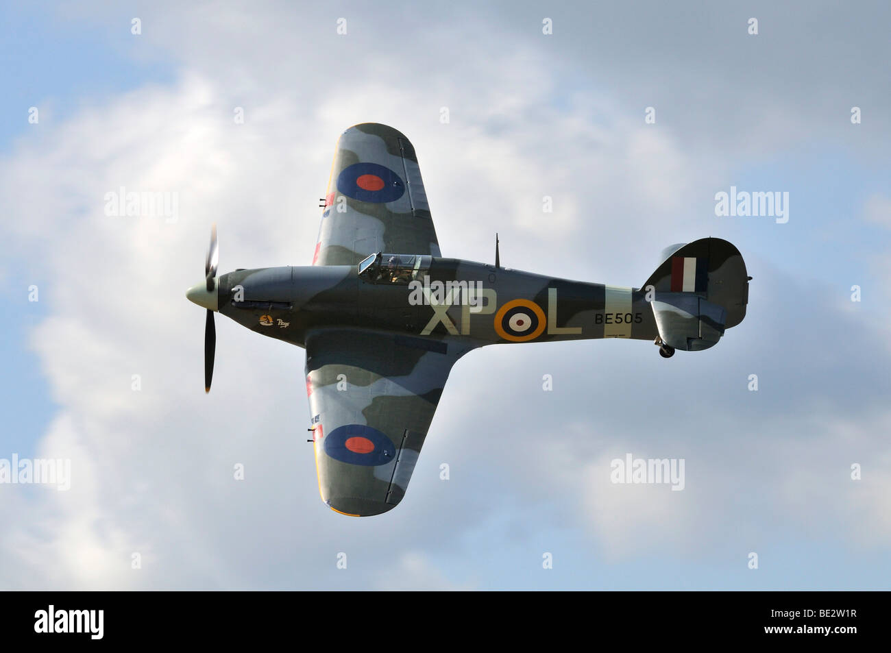 British Hawker Hurricane fighter plane during a flight demonstration, Europe's largest meeting of vintage planes - Stock Image