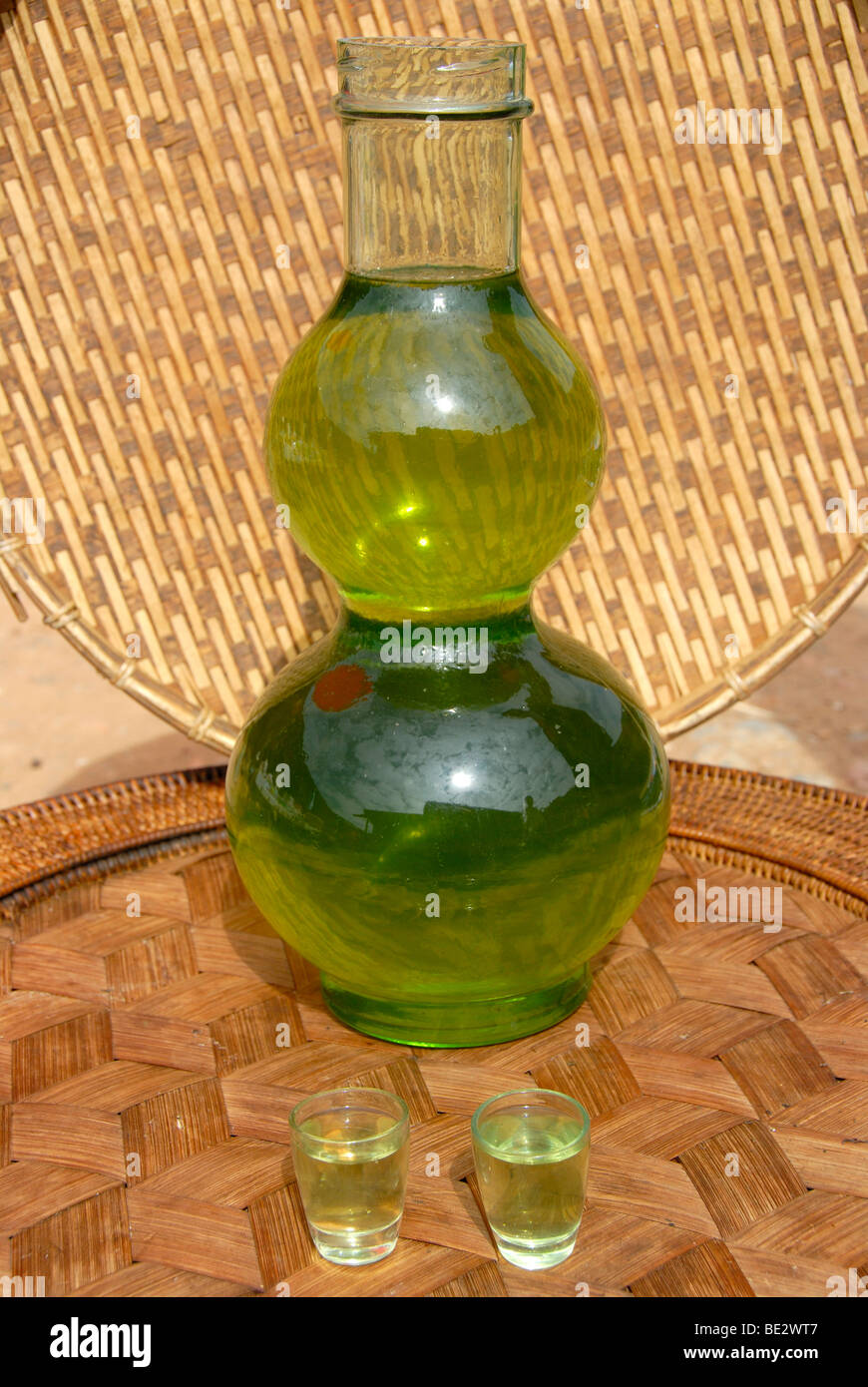 Green Lao Lao, bulbous glass bottle filled with alcohol, Laotian rice liquor, Phongsali, Phongsali province, Laos, - Stock Image