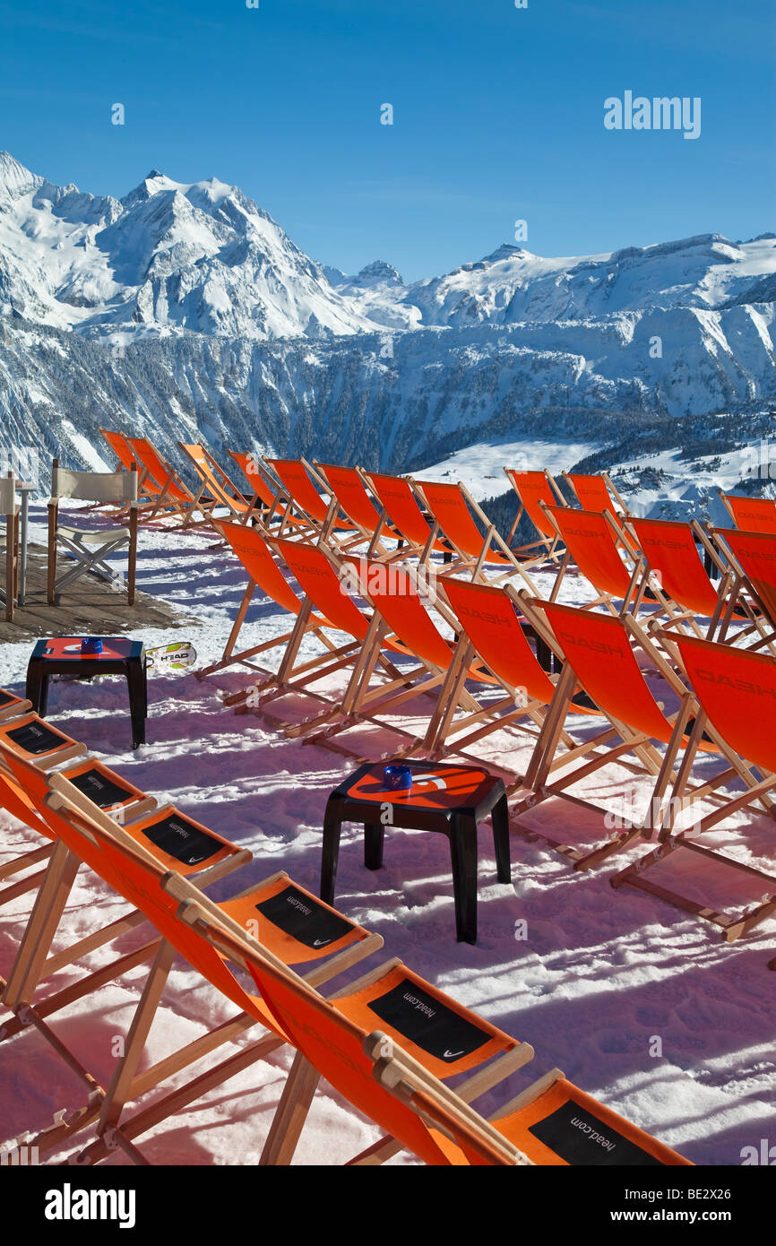 Sun Loungers, Courchevel 1850 ski resort in the Three Valleys, Les Trois Vallees, Savoie, French Alps, France - Stock Image