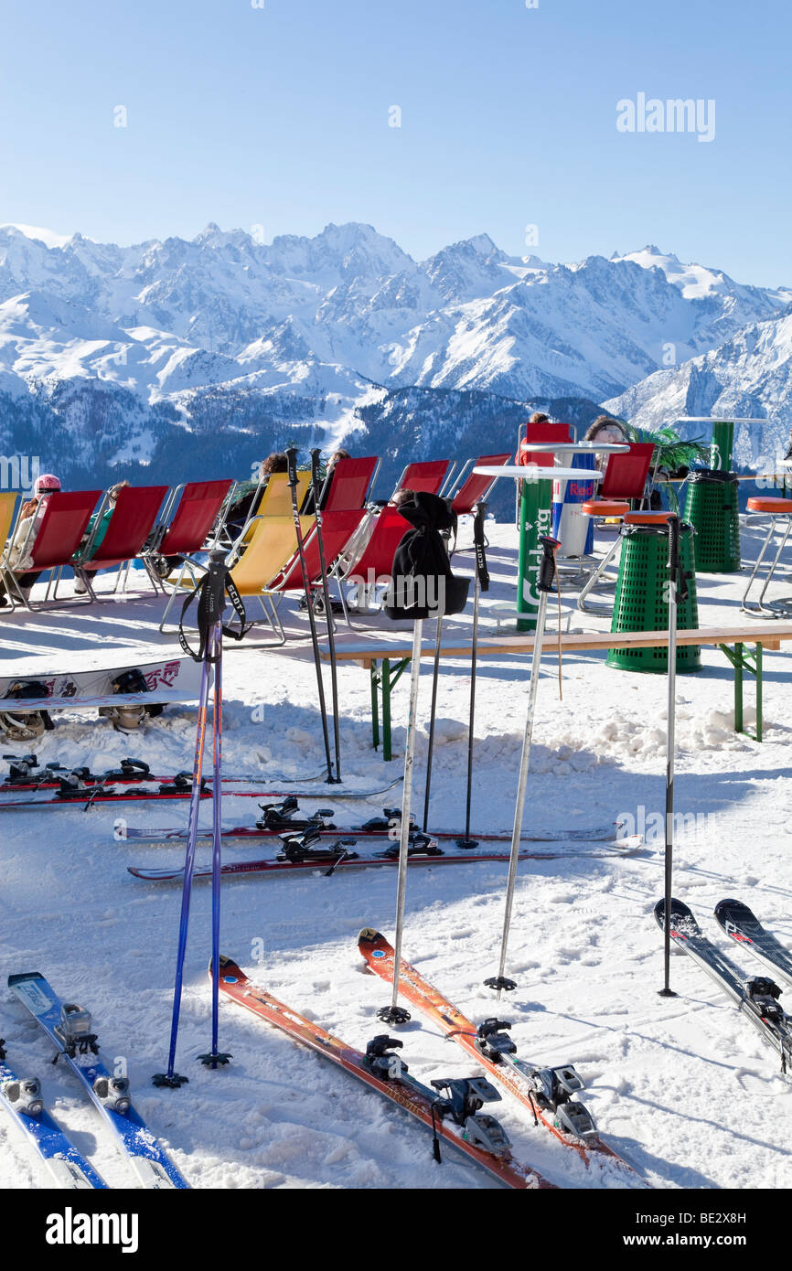 Sun Loungers outside a mountain restaurant, Verbier, Valais, Four Valleys region, Bernese Alps, Switzerland - Stock Image