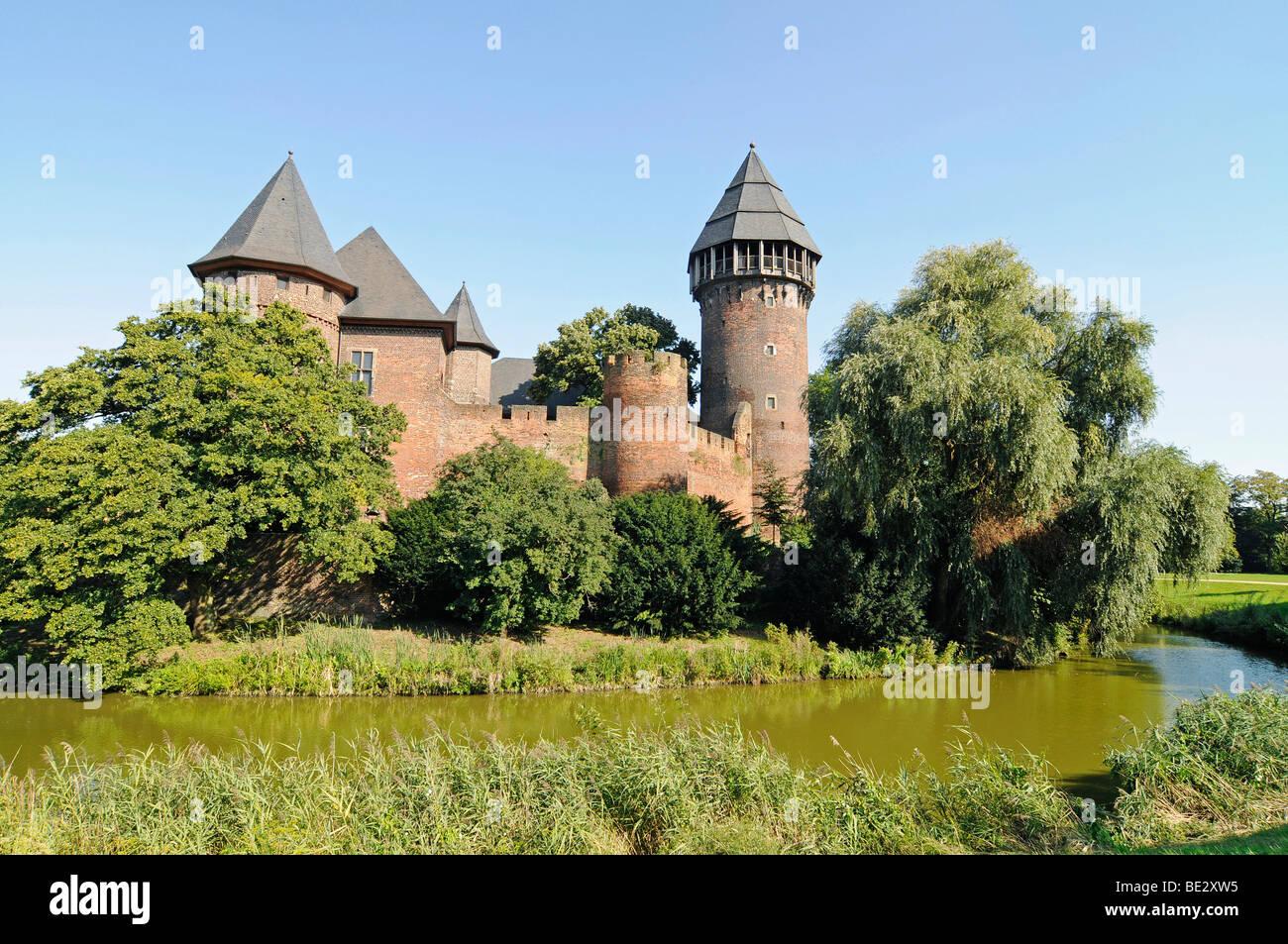 Castle park, moat, Wasserburg Linn moated castle, museum, Krefeld, North Rhine-Westphalia, Germany, Europe - Stock Image
