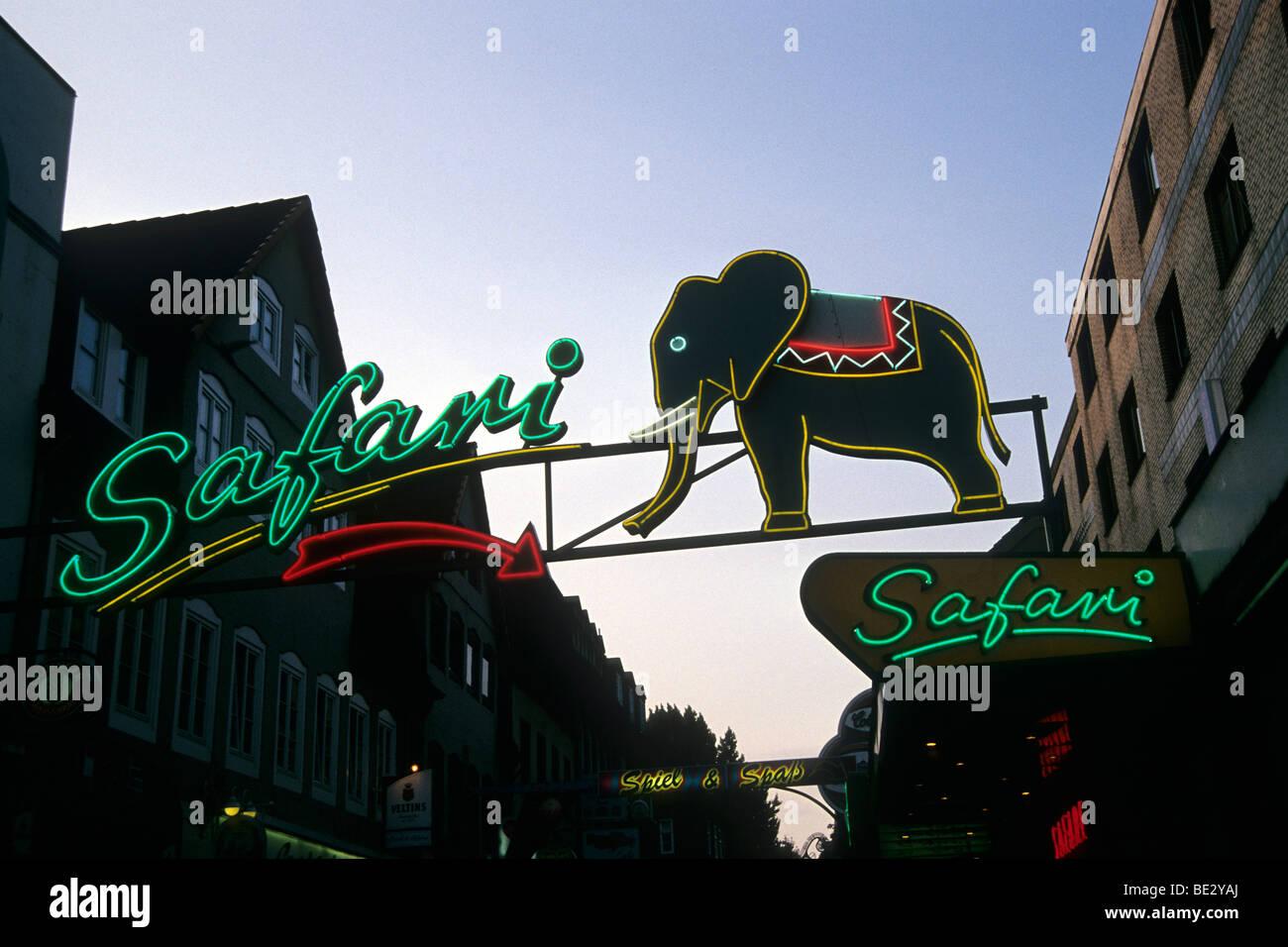 Safari lettering with a neon elephant, Kiez, Reeperbahn, St. Pauli, Hanseatic City of Hamburg, Germany, Europe - Stock Image