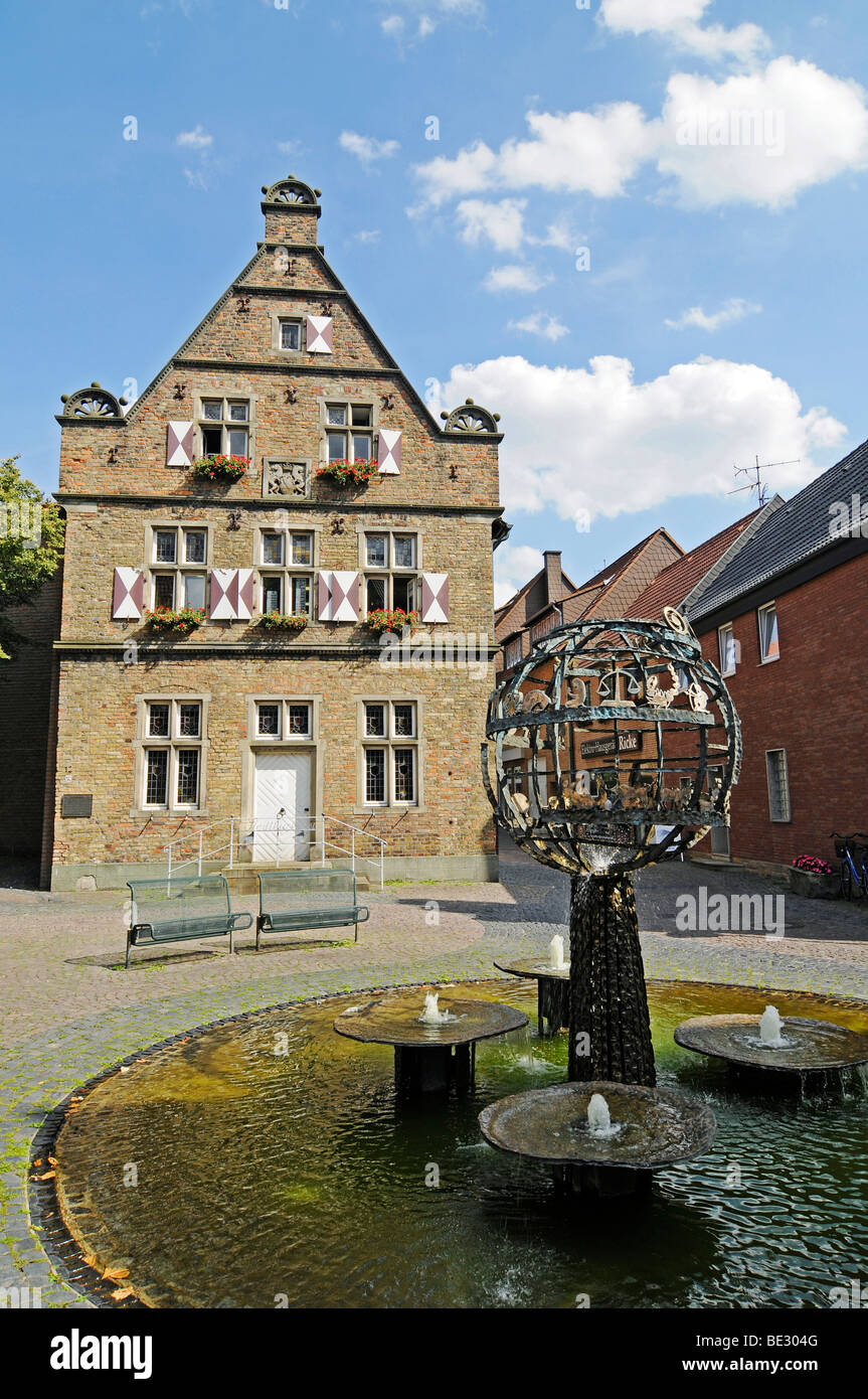 Fountain, Steinhaus building, public library, historic old town, Werne, Kreis Unna district, North Rhine-Westphalia, - Stock Image