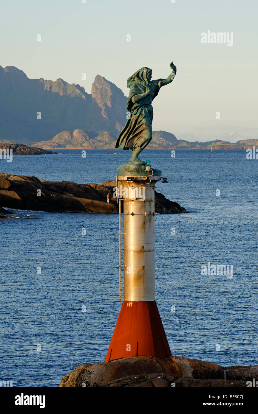 Fisherman's wife looking for her husband, bronze sculpture by Per Ung, 1999, entrance to the harbour, Svolvaer, - Stock Image