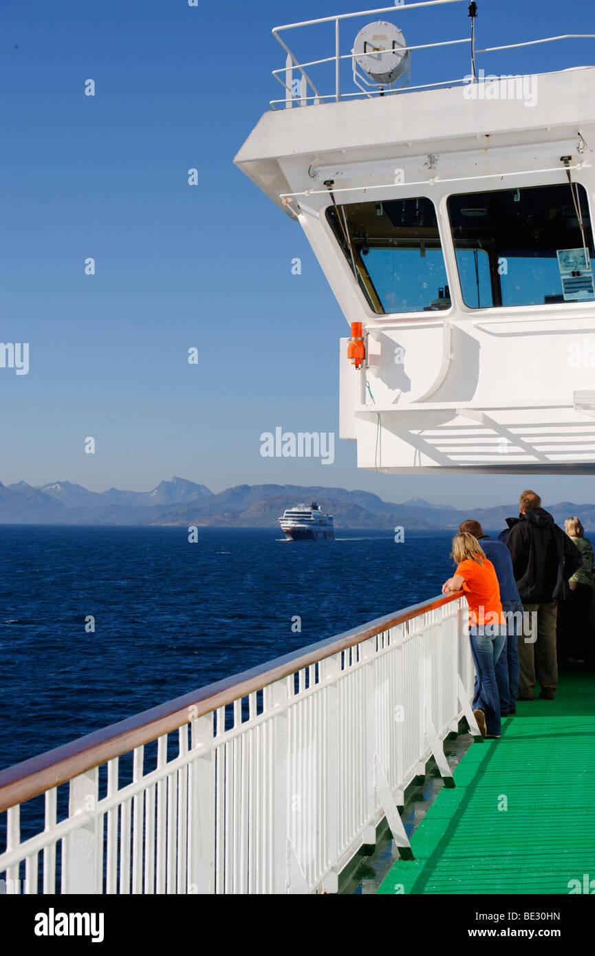 Encounter with MS Trollfjord, Hurtigruten, near Selsoyvik, Norway, Scandinavia, Europe - Stock Image