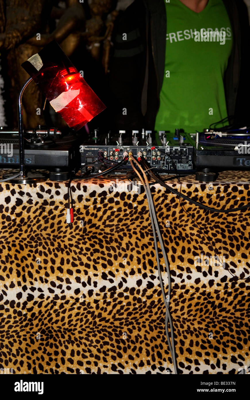 cropped view of dj at work on his turntables - Stock Image