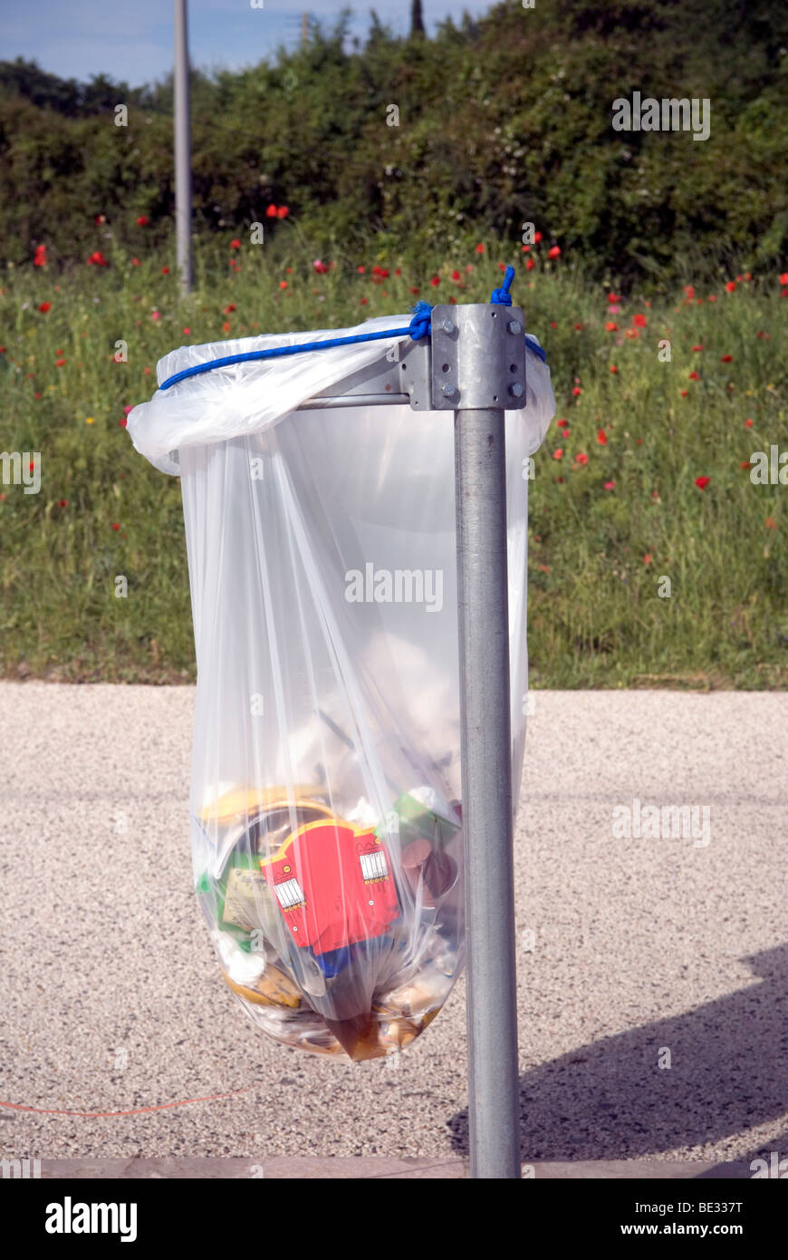 close up of street bin bag with contents - Stock Image