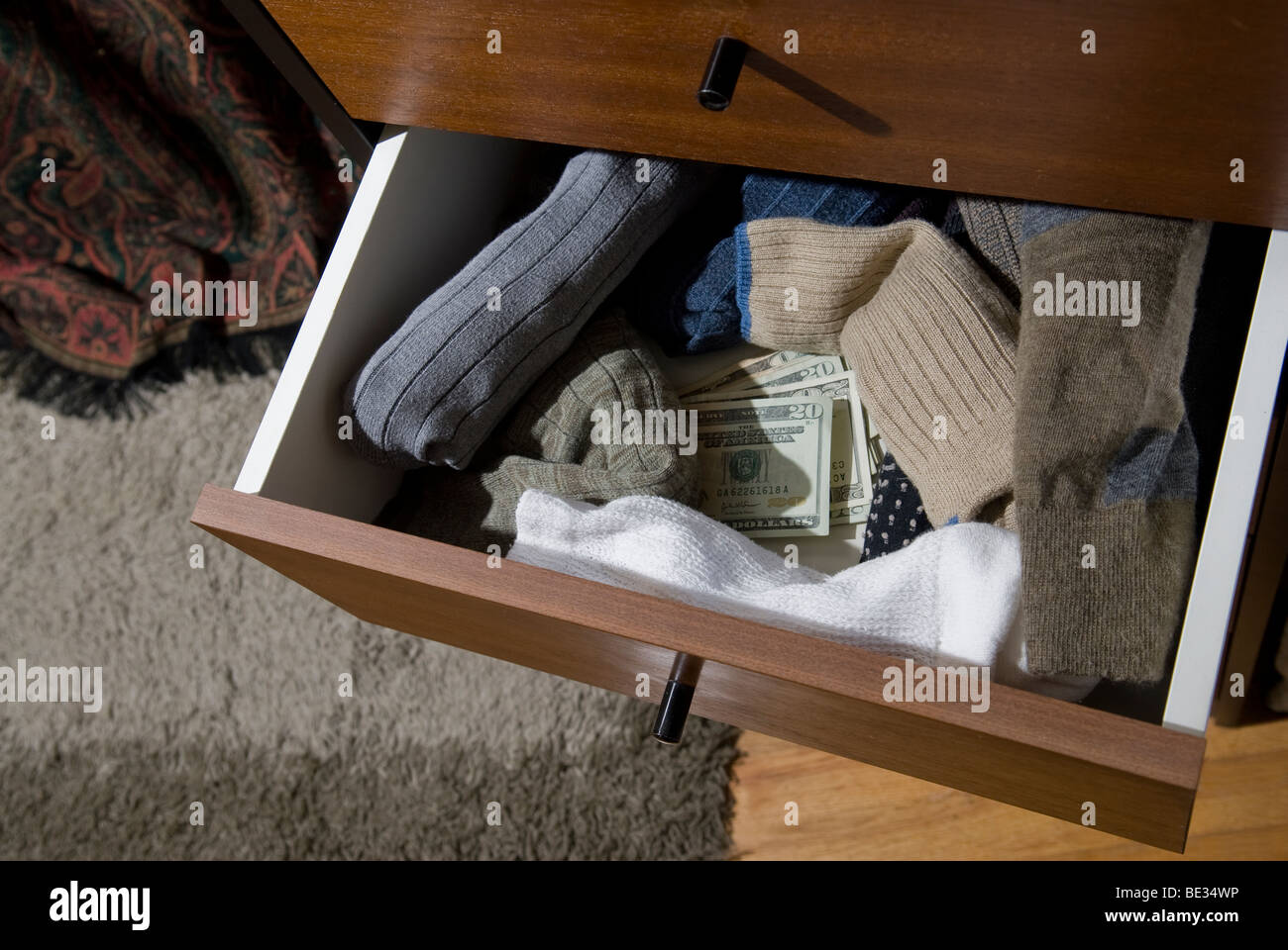 overhead view of money in drawer - Stock Image