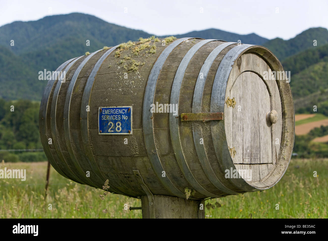 Wooden wine barrel converted into a post box, Mangles Valley, South Island, New Zealand Stock Photo