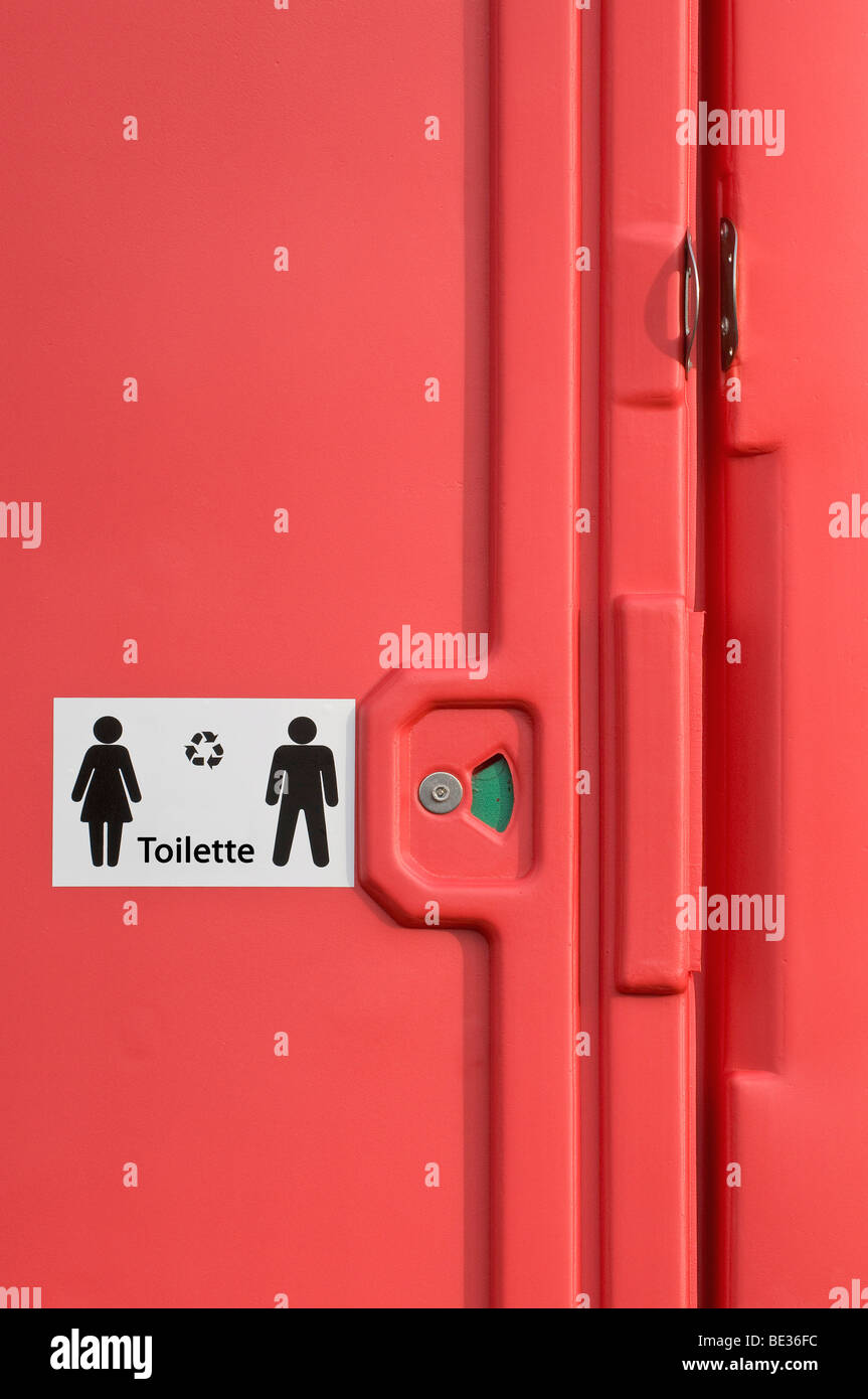 Detail of a red mobile rental toilet - Stock Image