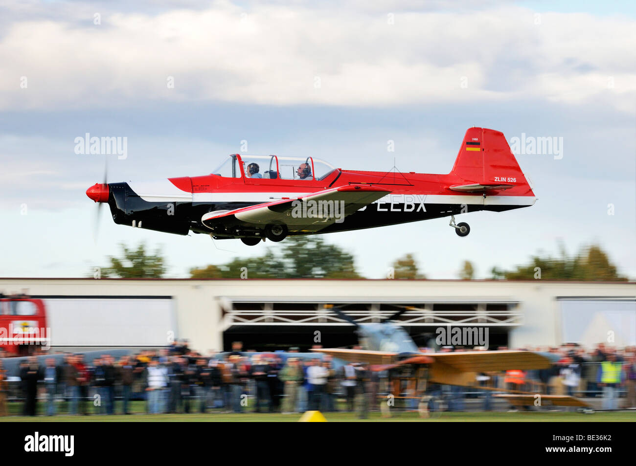 Czech sports and aerobatic aircraft Zlin Z-526 immediately after take-off, Europe's largest meeting of vintage - Stock Image