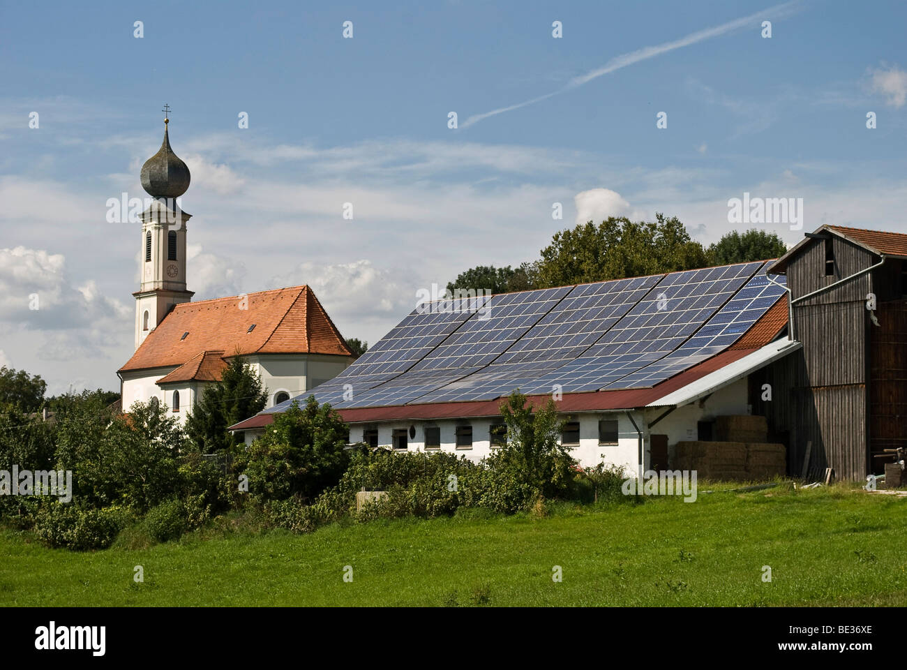 Solar system on an agricultural building in Bavaria, Germany, Europe - Stock Image