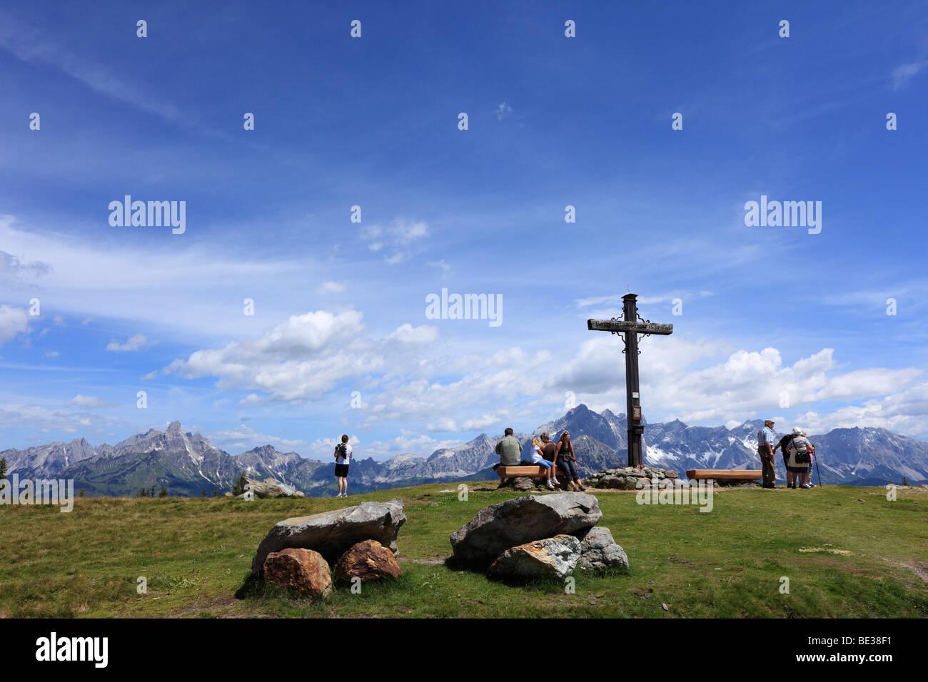 Summit cross on Mt. Rossbrand, in the back Mt. Dachstein, Pongau, Land Salzburg, Salzburg, Austria, Europe Stock Photo