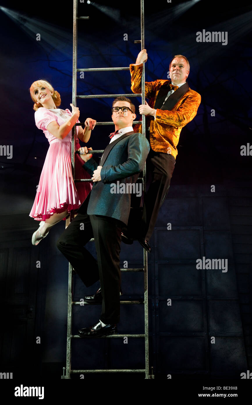 The Narrator (Steve Pemberton) with Brad (Mark Evans) and Janet (Haley Flaherty) Rocky Horror Show at New Wimbledon - Stock Image