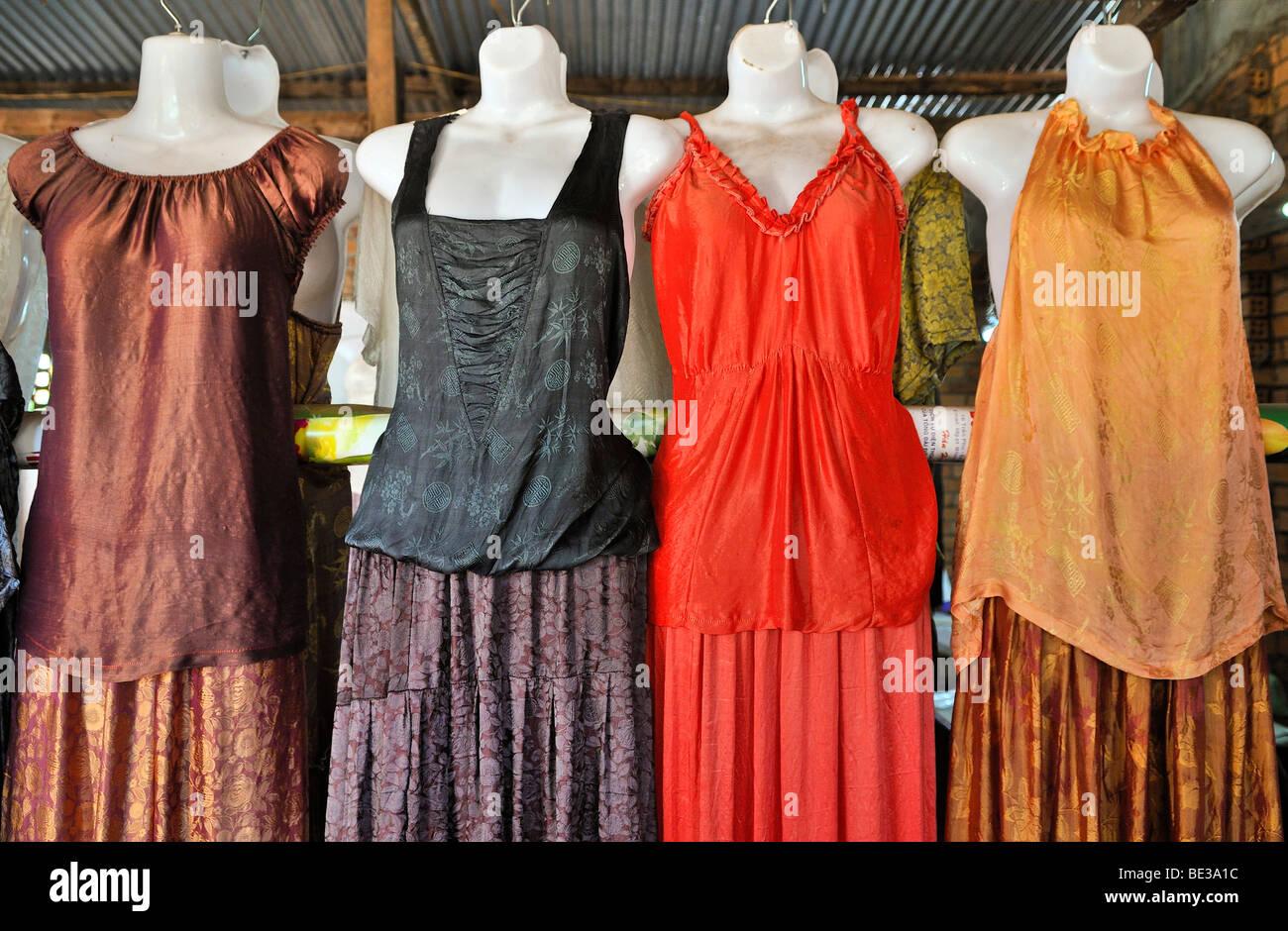 Colorful silk dresses on mannequins, Dalat capital, Central Highlands, Vietnam, Asia - Stock Image