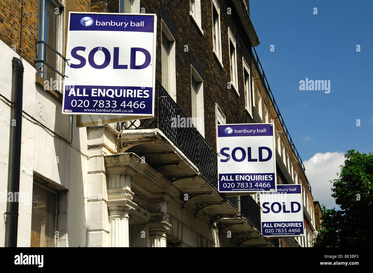 'Sold' signs of the Banbury Ball estate agents at a building, London, United Kingdom, Europe - Stock Image