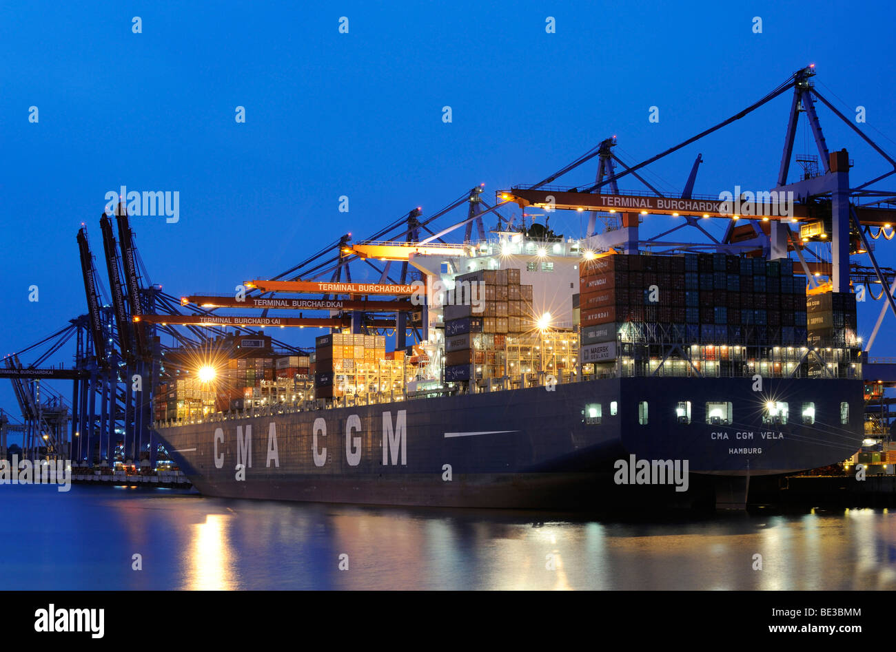 Container ship being loaded at the Burchardkai Terminal, Hamburg, Germany, Europe Stock Photo