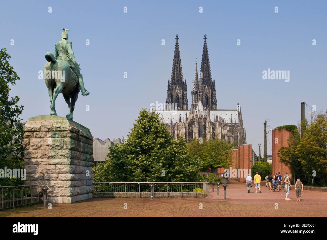 Equestrian statue of the Emperor Wilhelm II of Prussia, at the Hohenzollernbruecke Bridge, cathedral in the back, - Stock Image