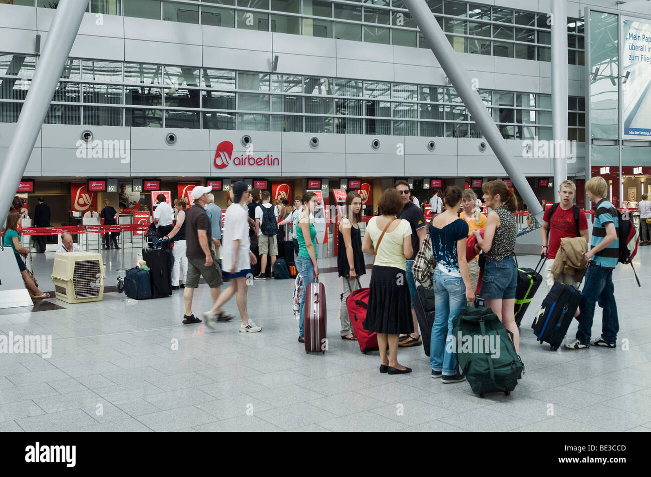 Passengers in front of the check-in counter of airberlin, Duesseldorf International Airport, North Rhine-Westphalia, - Stock Image