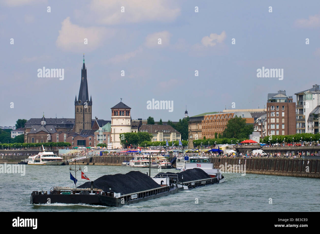 Panoramic view of Rhine River, Lambertuskirche Church, from Burgplatz Square to the old harbour, cargo ship on Rhine - Stock Image