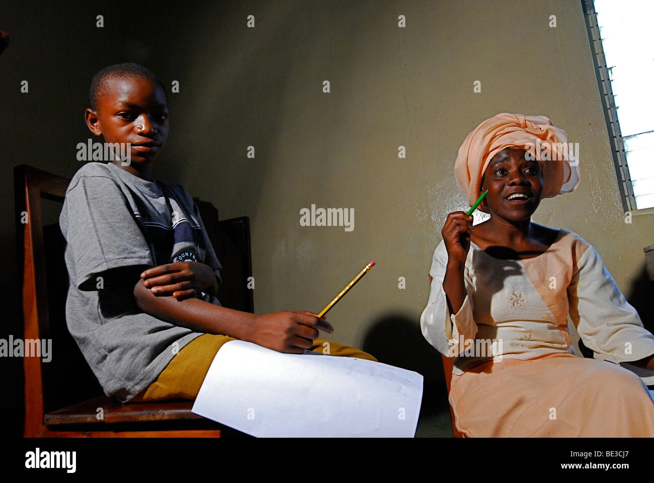 Student with autism and a therapist, Soni, Tanzania, Africa - Stock Image