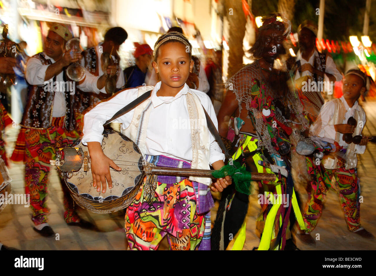 Boy with Gimbri, stringed percussion instrument, Sufi brotherhood, religious ceremony, Hammamet, Tunisia, Northern - Stock Image