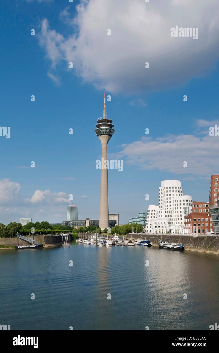 Duesseldorf Harbour, Rheinturm Tower and Neuer Zollhof, 'Tanzende Buerobauten' by F. O. Gehry, pleasure - Stock Image
