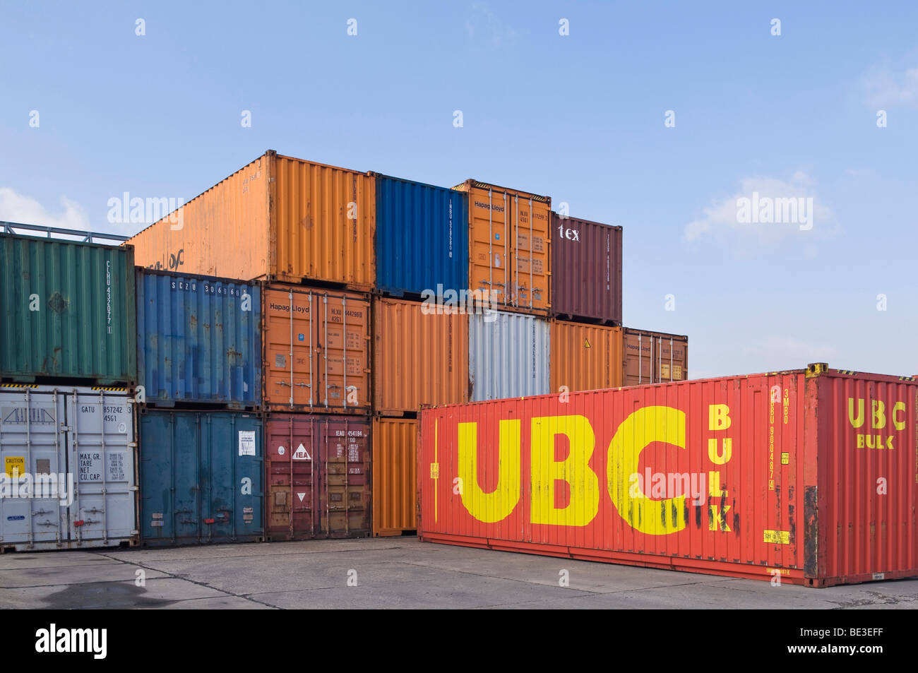 Stacked oversea containers in a depot, container terminal in Bonn, North Rhine-Westphalia, Germany, Europe - Stock Image