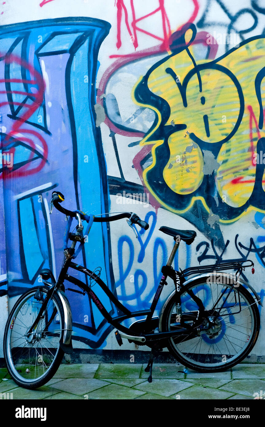 A parked bicycle in Amsterdam, Holland - Stock Image