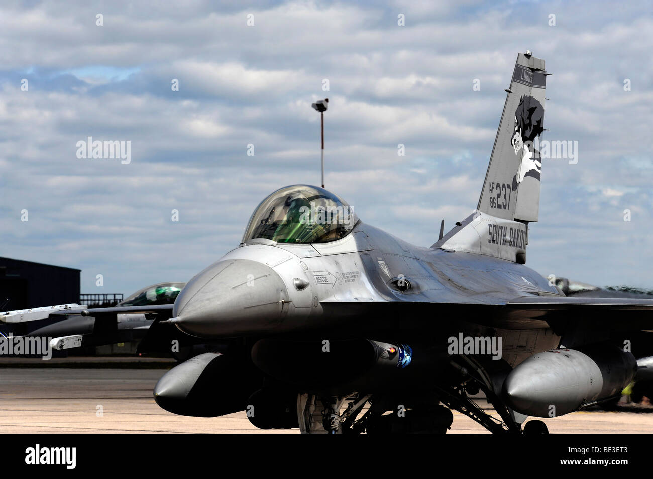An F-16 Fighting Falcon taxis out for a training mission. - Stock Image