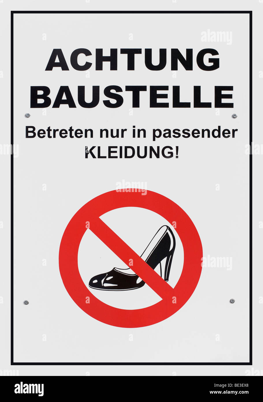 German sign, Danger, building site, entering only in appropriate clothes, with crossed-out high-heel symbol - Stock Image