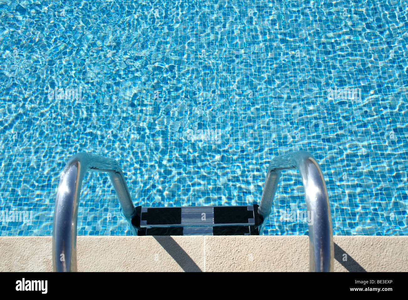 Hotel swimming pool with sunny reflections, great for summer and vacations themes and backgrounds - Stock Image