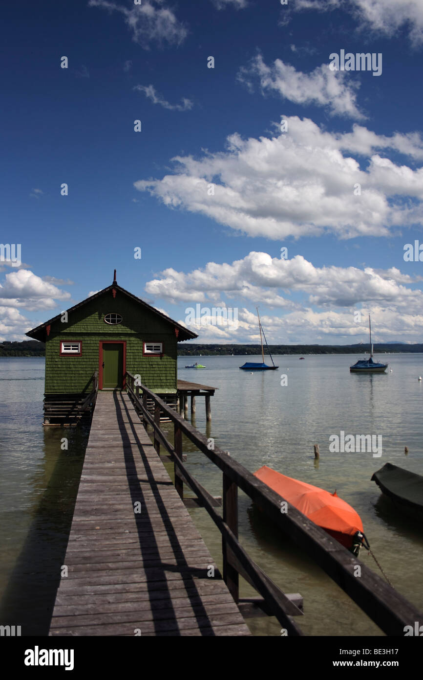 Boat house with wooden jetty on Ammersee Lake, near Schondorf, Upper Bavaria, Germany, Europe - Stock Image