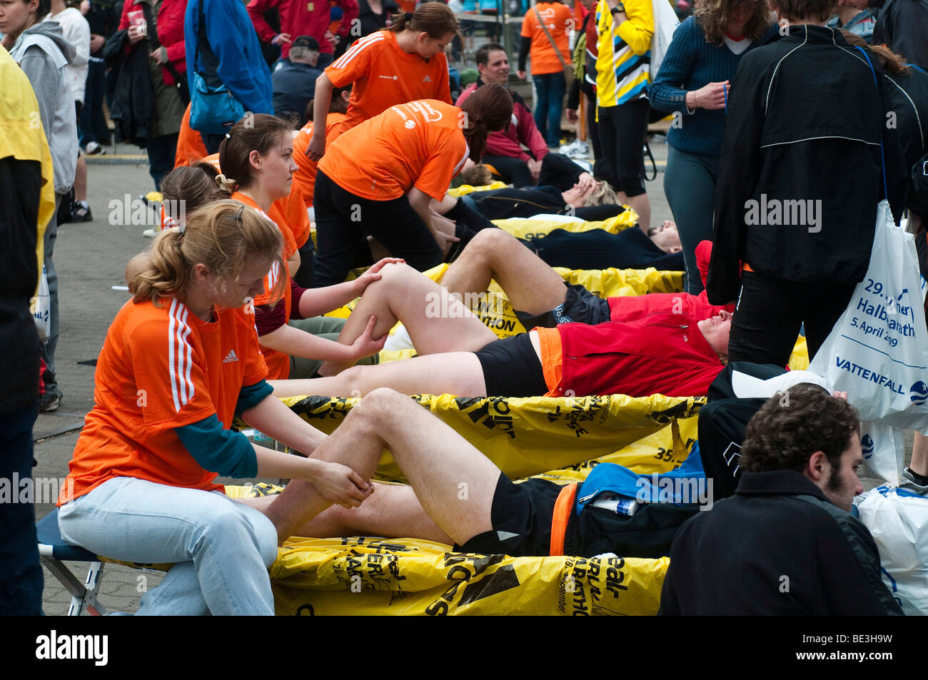 After the race runners can get massages, half marathon with over 25, 000 runners and wheelchair users, Berlin, Germany, - Stock Image