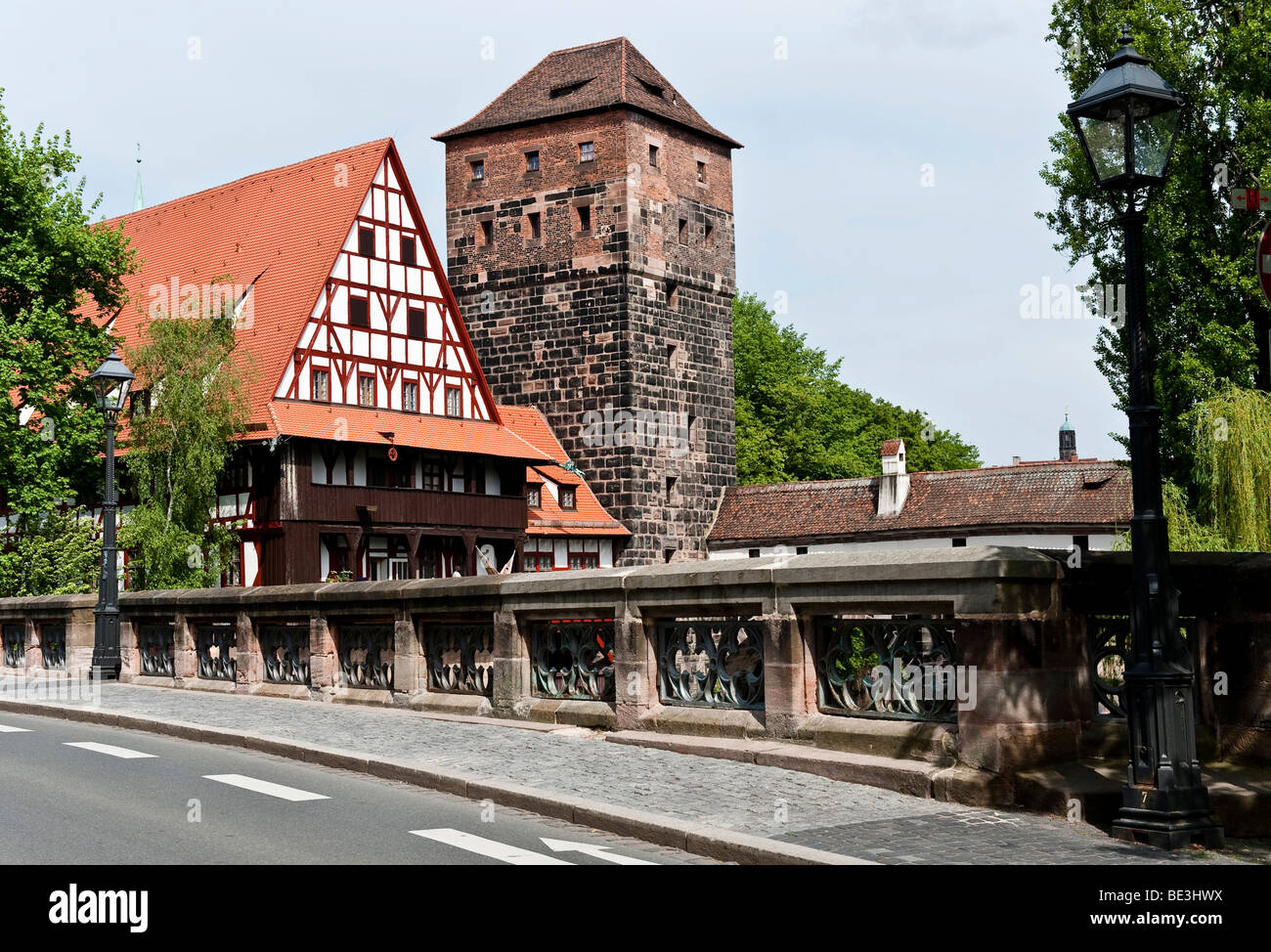 Pegnitz river with Maxbruecke bridge, Weinstadel building, Henkersteg executioner path in front of the historic - Stock Image