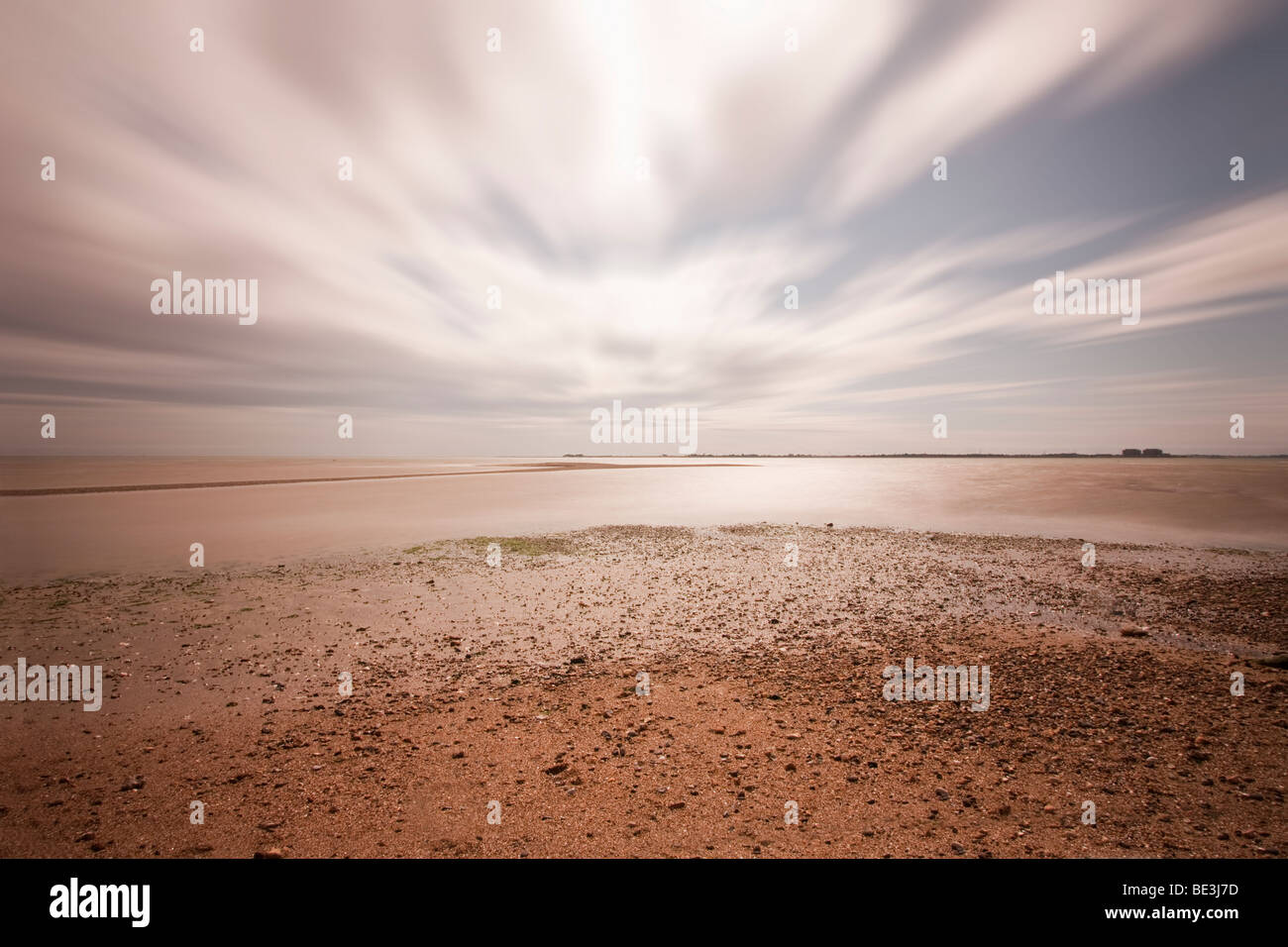 Long exposure of the beach at mersea in essex with a dramatic big sky - Stock Image