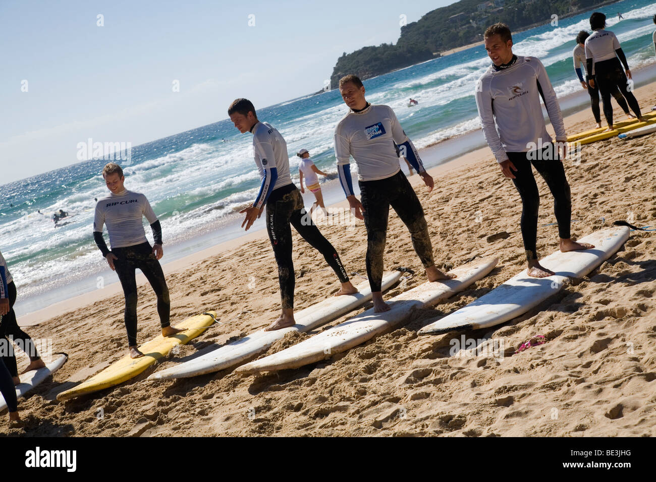 Surfing lesson on the sands of Manly Beach. Sydney, New South Wales, AUSTRALIA - Stock Image