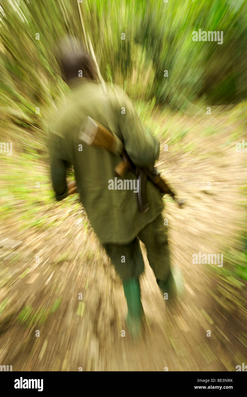 Park ranger with AK-47 in Kyambura River Gorge in Queen Elizabeth National Park in Western Uganda. - Stock Image